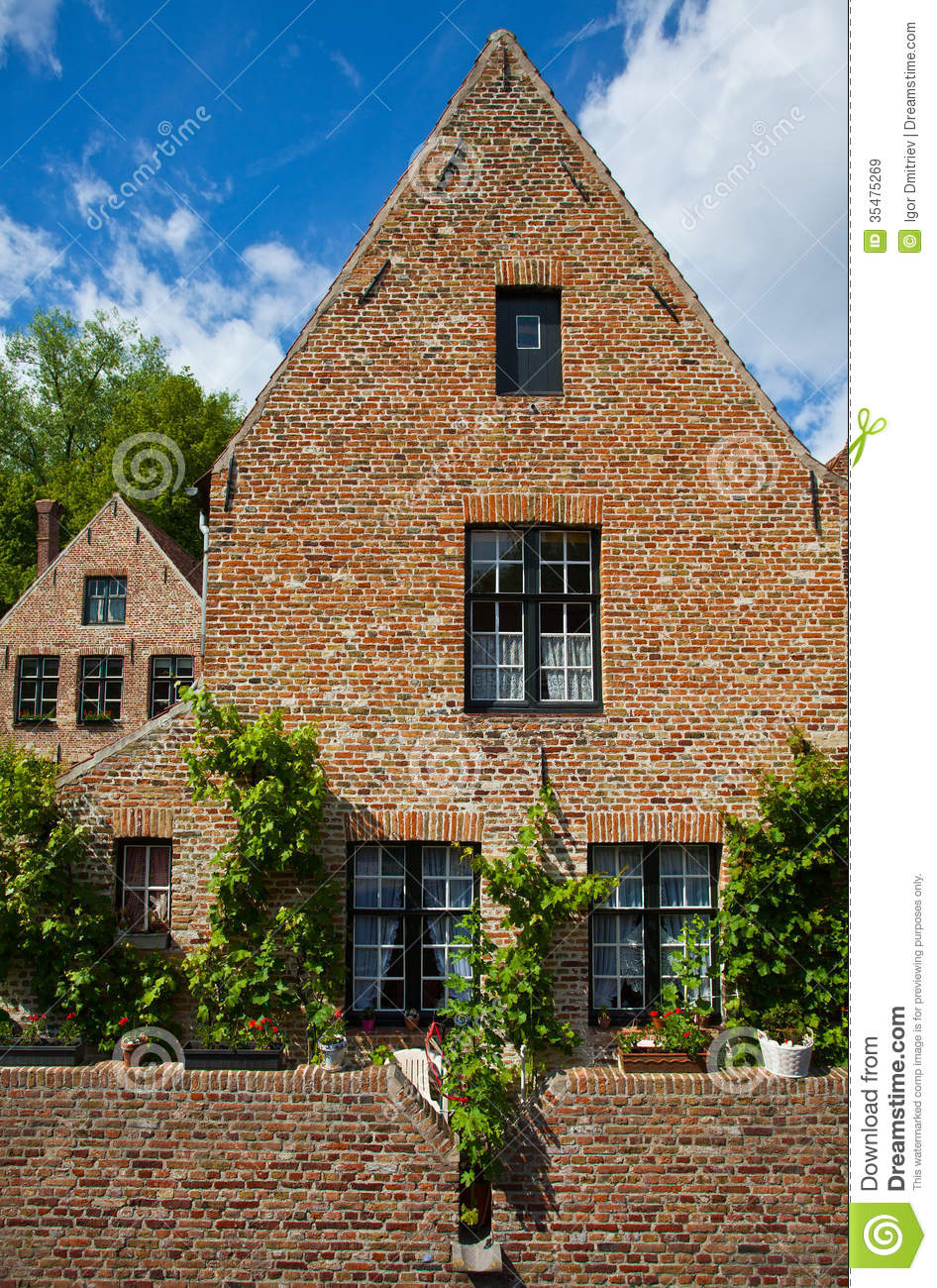 European small street with old brick houses in a bright sunny da royalty free stock images - Small belgian houses brick ...