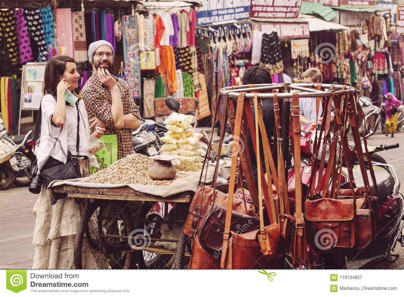 European Tourist Couple Buying Nuts From The Street Seller Editorial