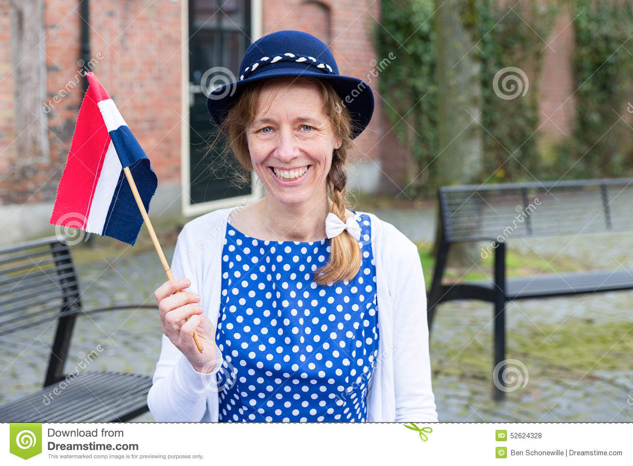 European woman celebrating liberation with dutch flag