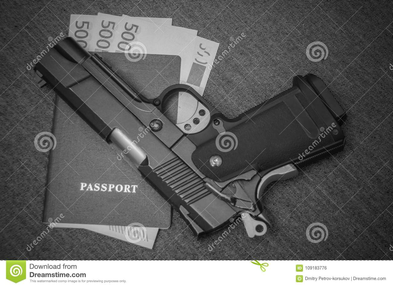 Next To The Pistol Euros Money Invested In The Passport Stock Photo