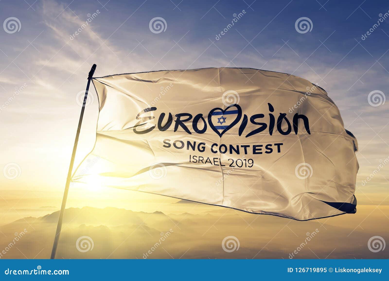 Eurovision Song Contest 2019 logo flag textile cloth fabric waving on the top sunrise mist fog