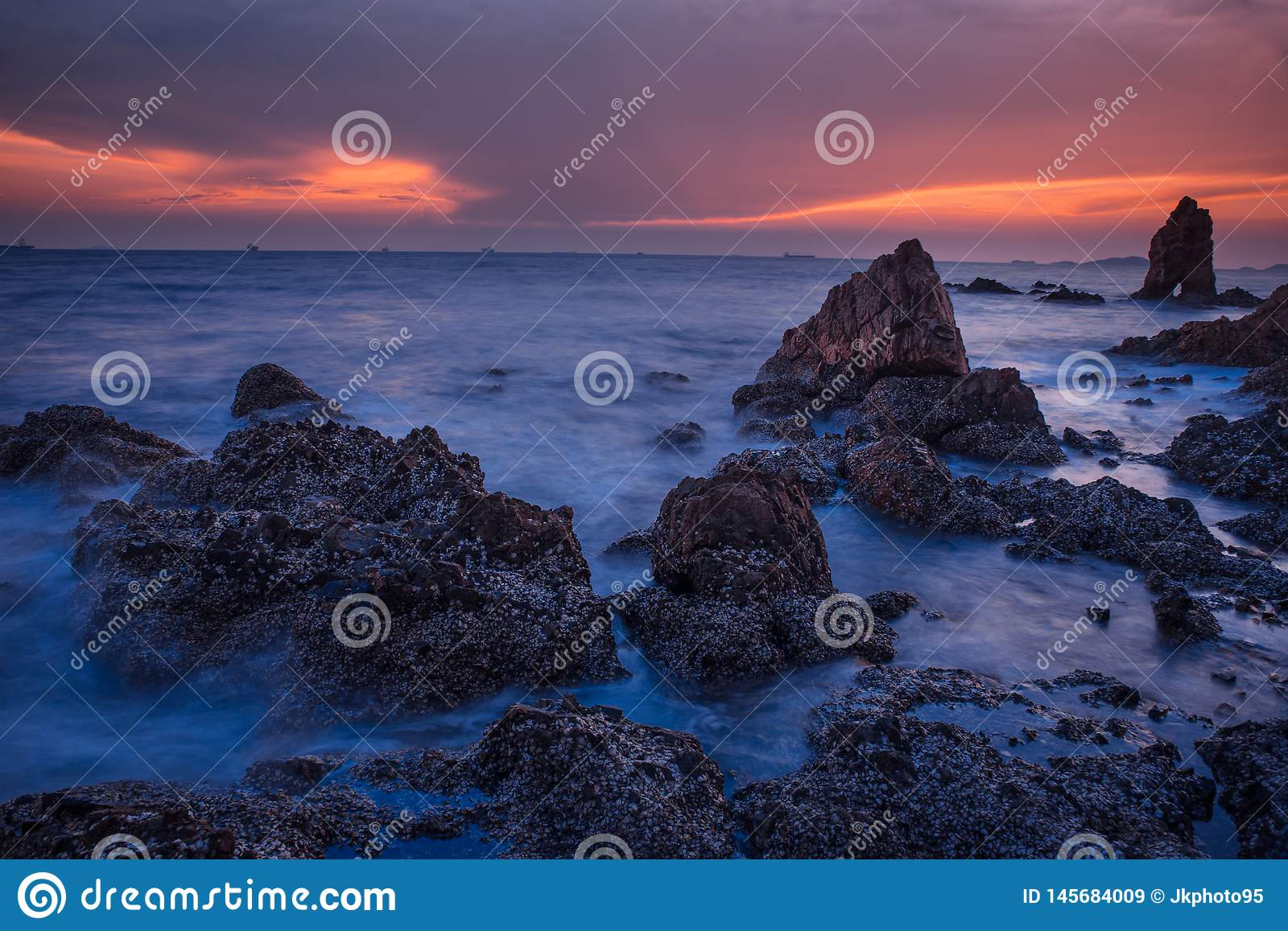 Evening sea on Gray and Orange sky background