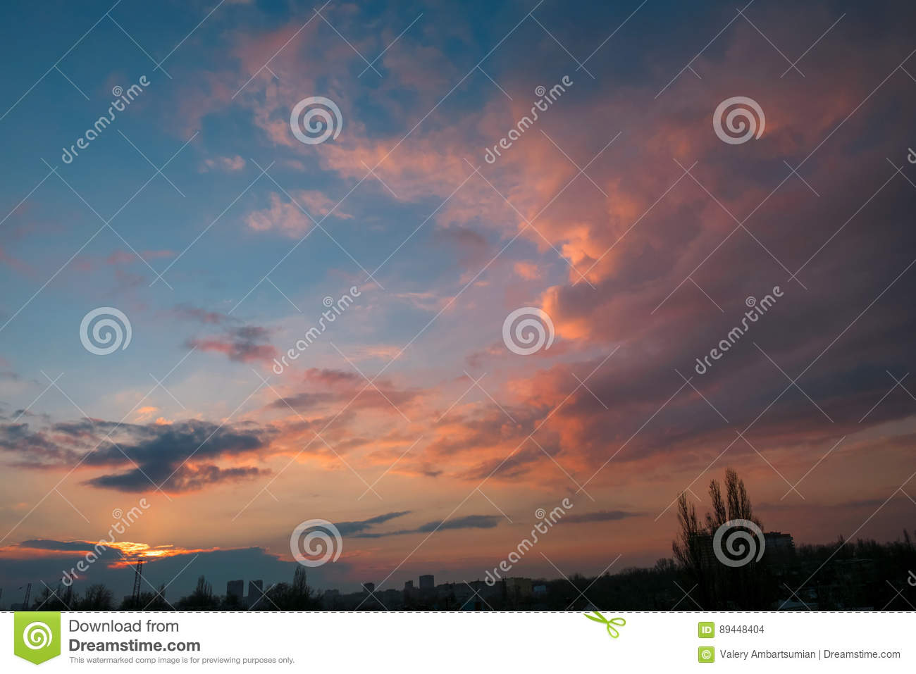 Evening sky at sunset with beautiful clouds over the city
