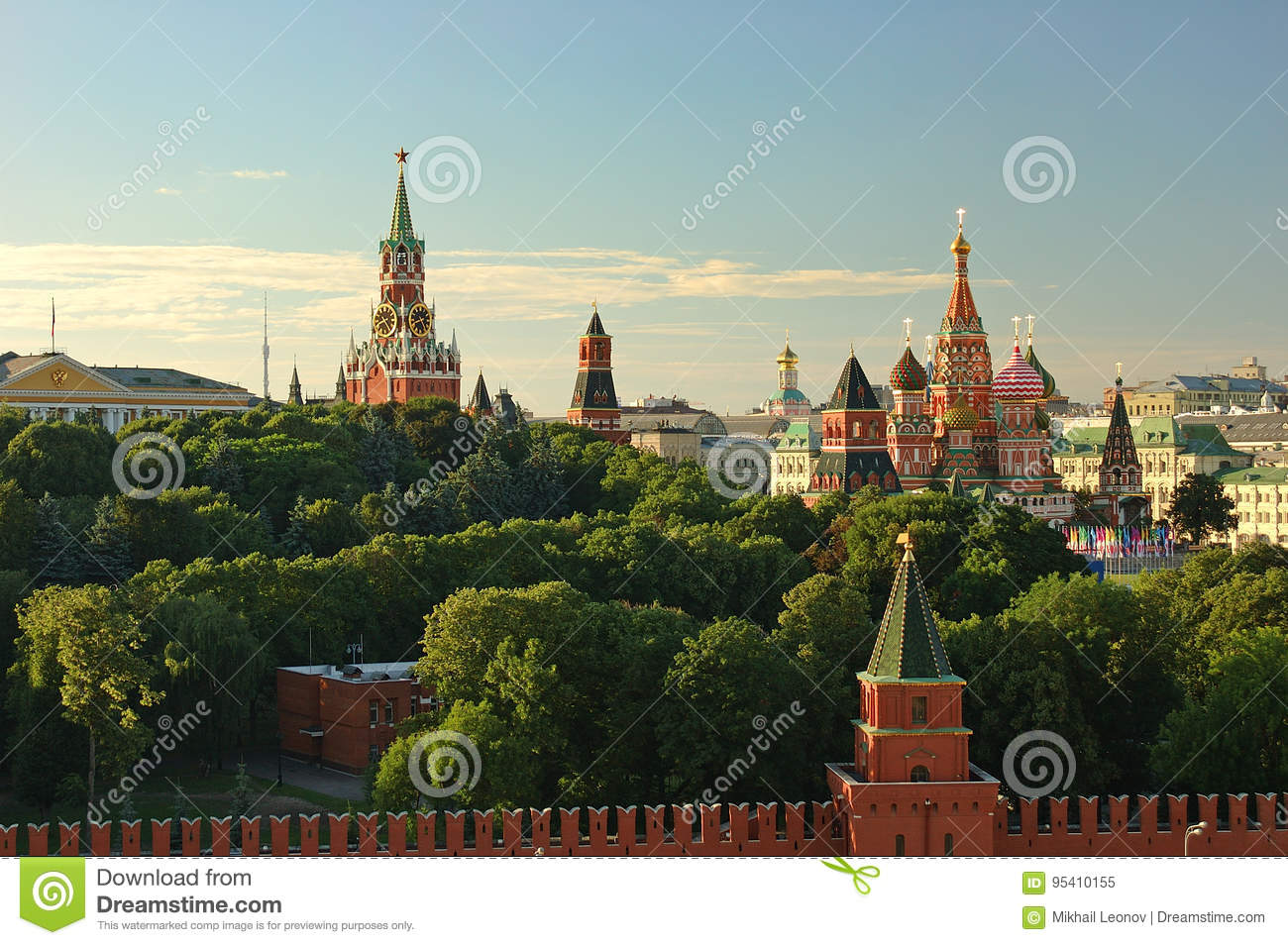 Evening view on Moscow Red Square Kremlin towers red square wall stars and Clock Kuranti Saint Basil Cathedral church. Panorama fr