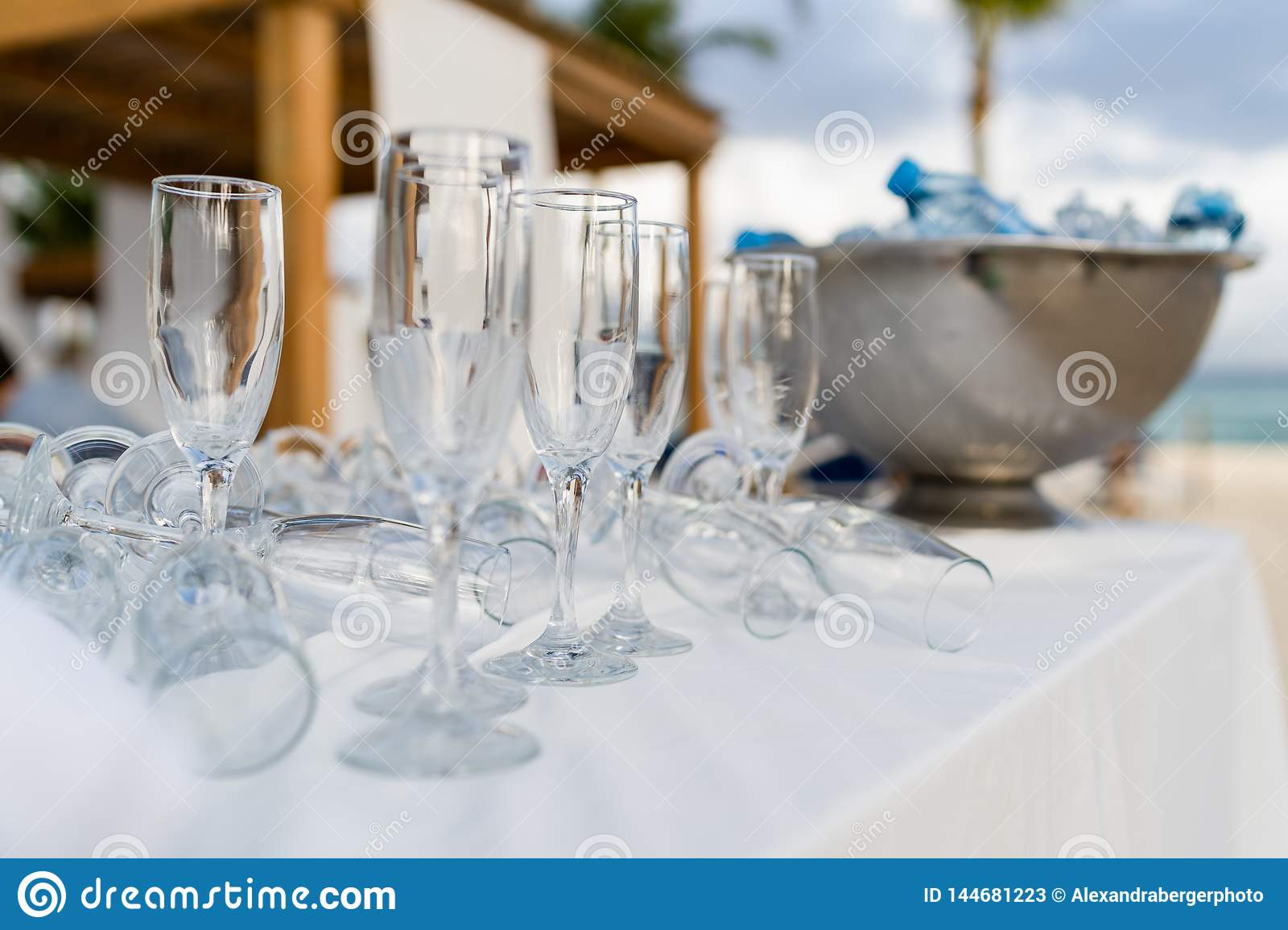 Empty glasses before reception with cooler in the background