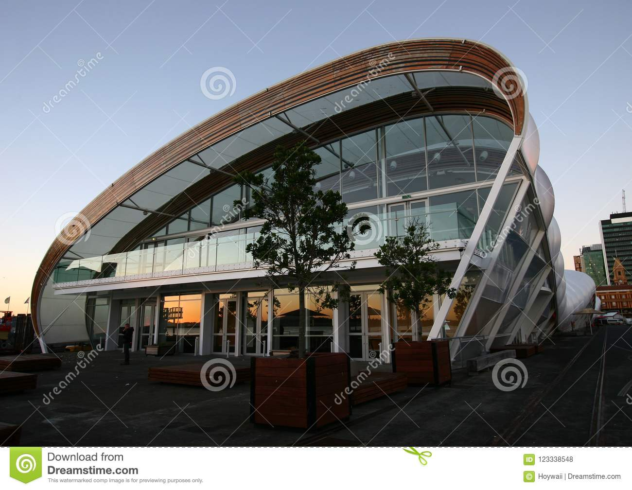 Modern Curved Outdoor Glass Facade And Elliptical Roof Of Cloud At