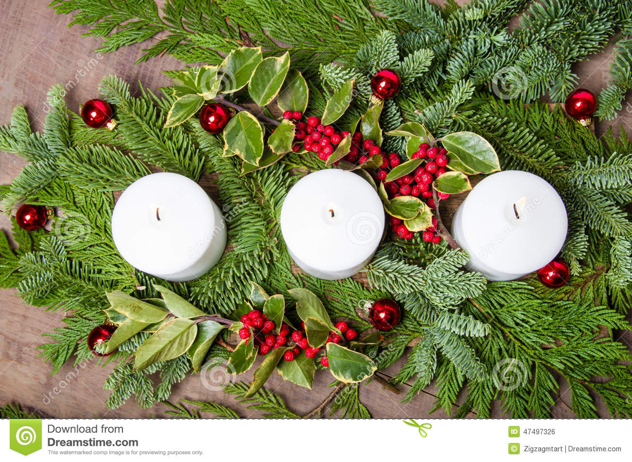 an evergreen christmas centerpiece with three white candles and holly berries - An Evergreen Christmas