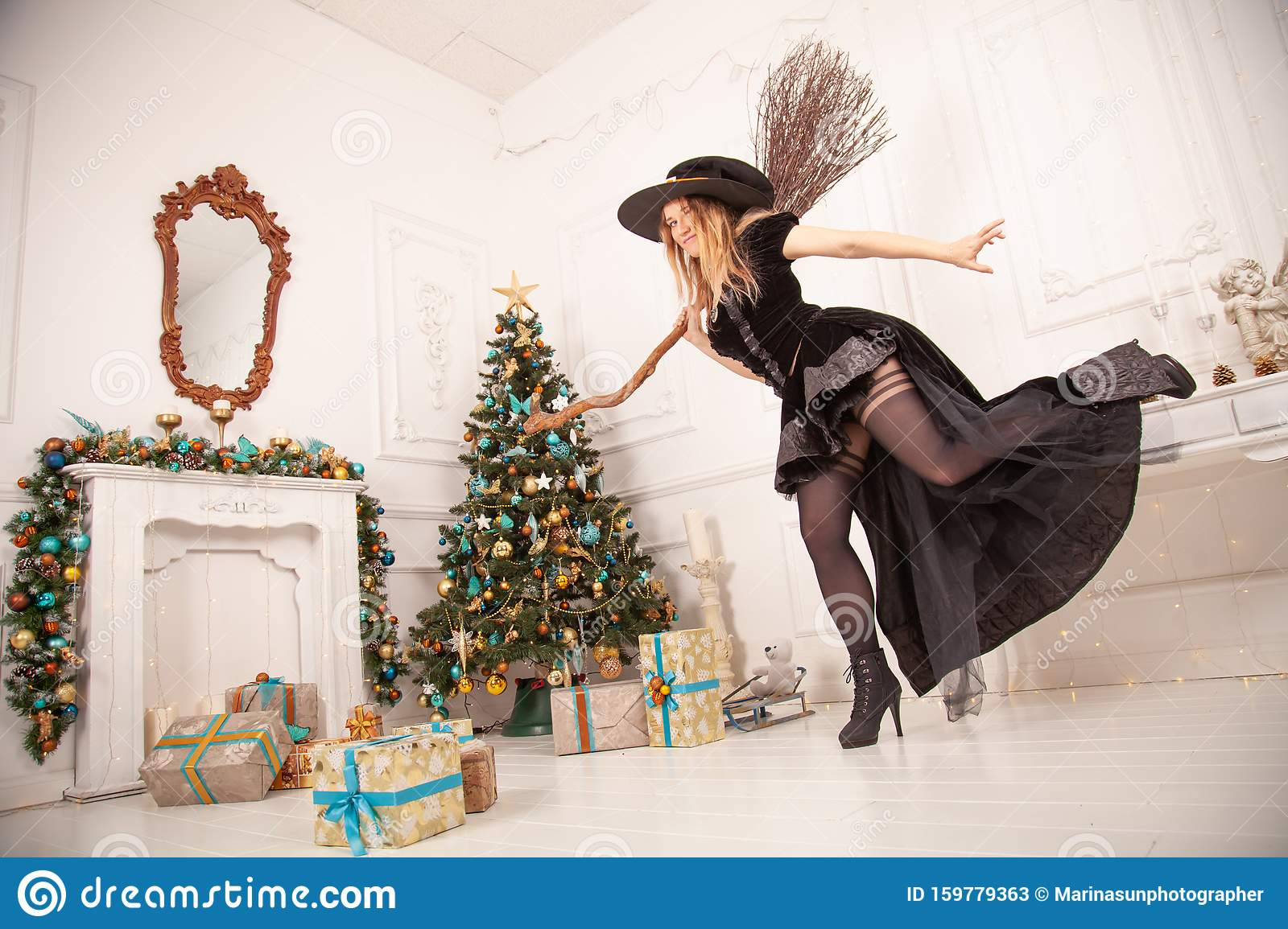 The Evil Witch In Black Dress And Scary Hat From Halloween Came For Christmas And Tries To Spoil A Holiday Swinging The Stock Image Image Of Green Expression 159779363