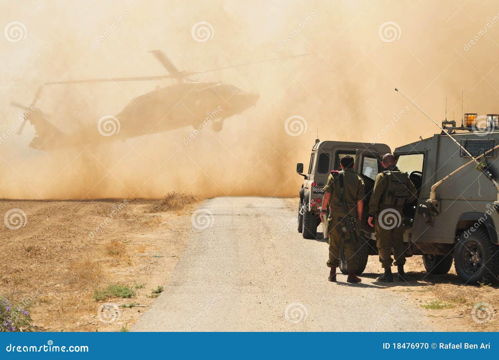 Exército e helicóptero israelitas