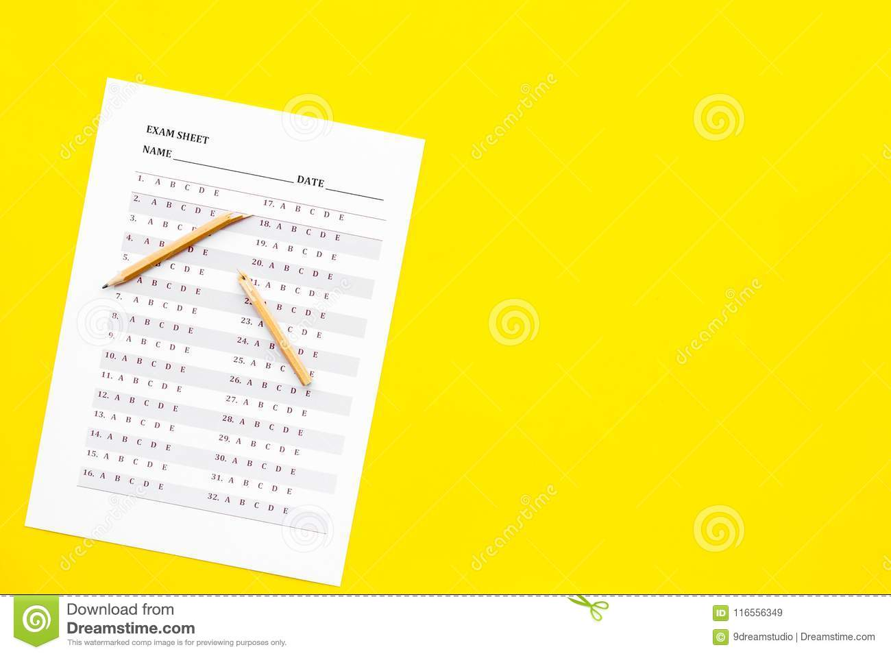 Exam Sheet On Yellow Table Top View Copy Space  Education