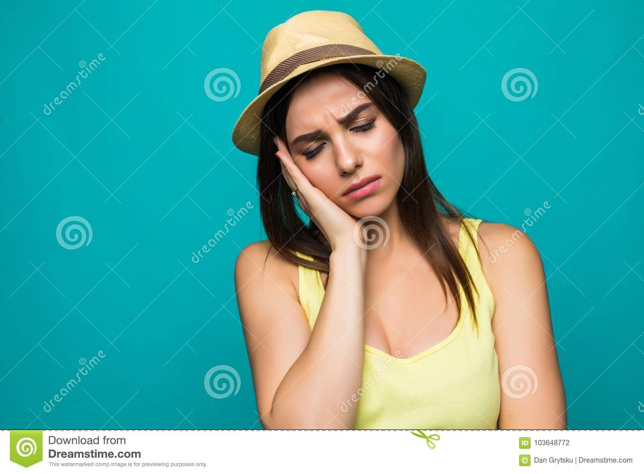 Exasperate female keeps hands on temples, feels strong headache, closes eyes with pain, need healthy sleep, being overworked, fati