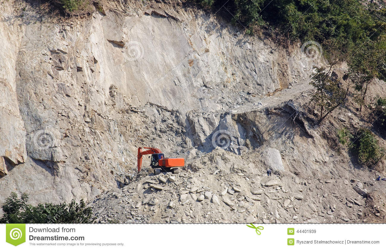 Excavator building the road on a steep slope stock photo for Cost of building on a steep slope