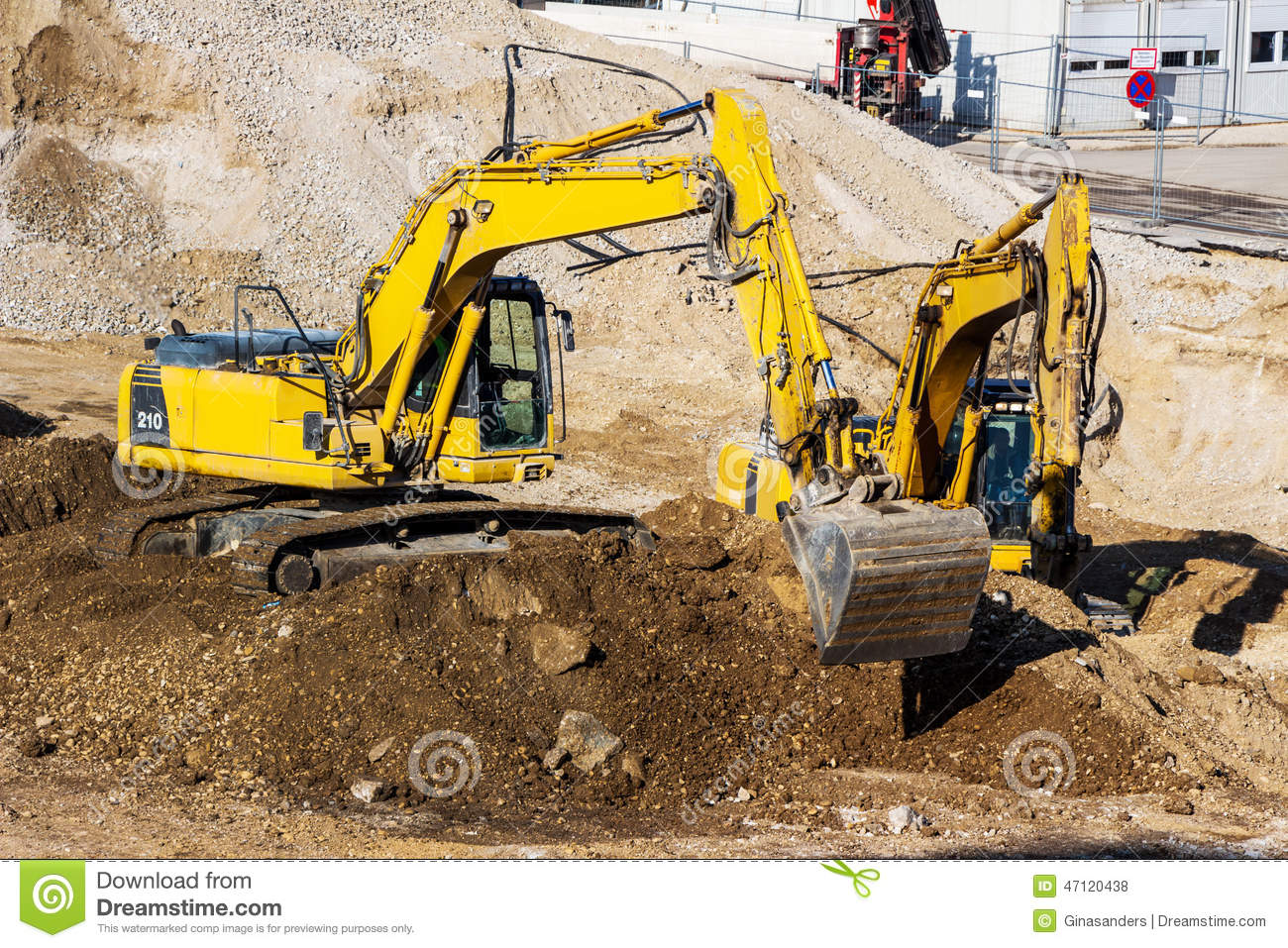 Construction Site Soil : Excavator on construction site during earthworks stock