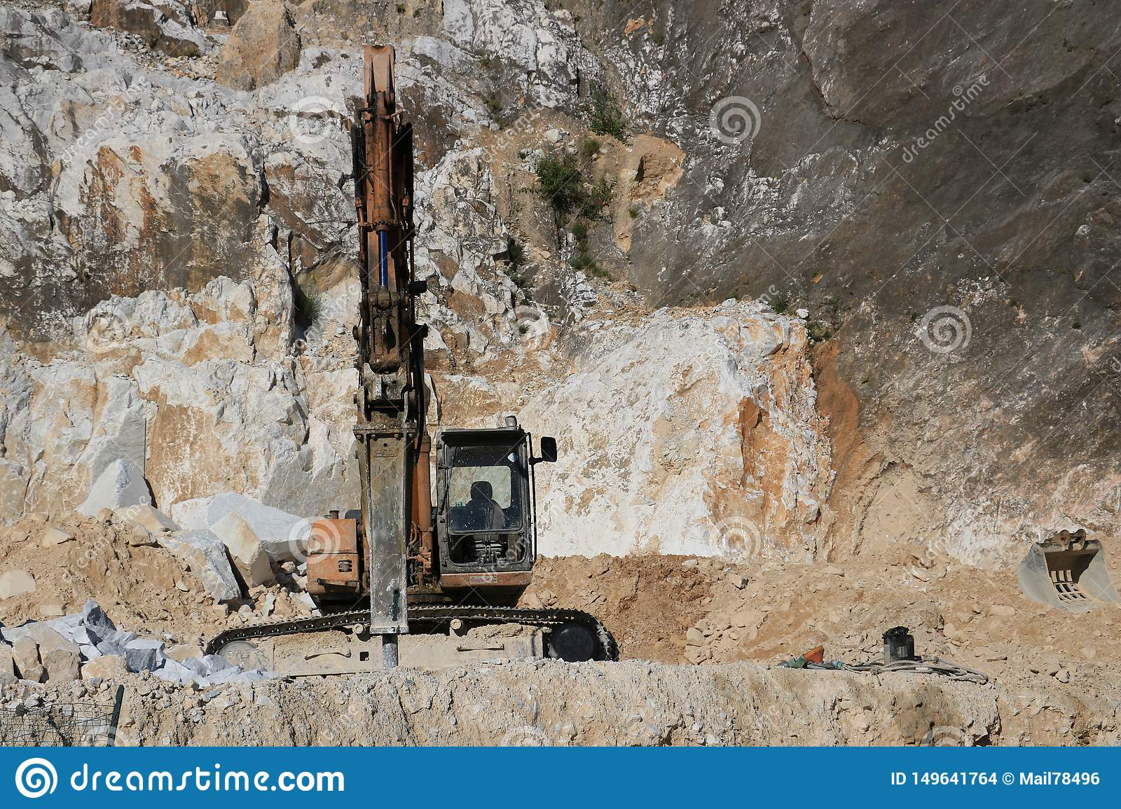 Excavator With Demolition Hammer In A Carrara Marble Quarry