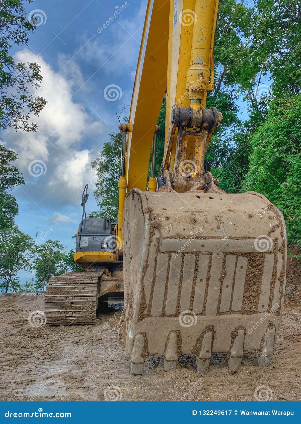 An excavator dozer working on road construction site