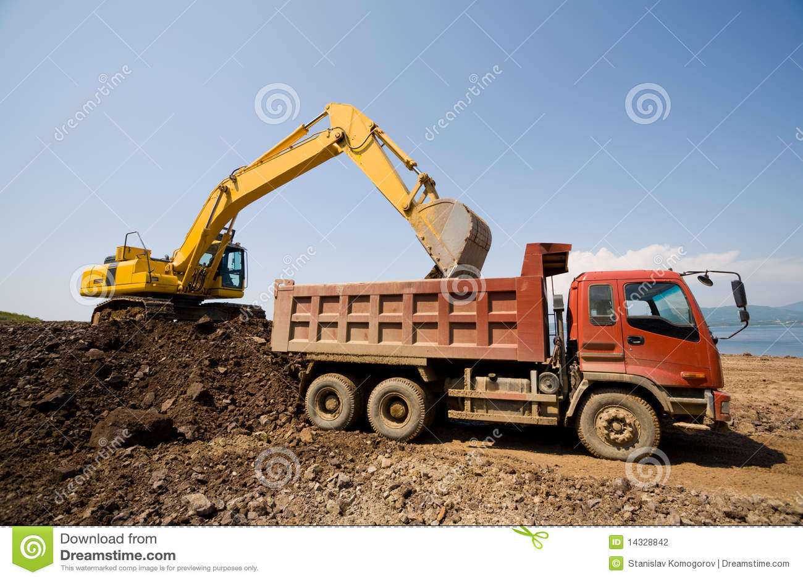 Excavator and heavy dump truck