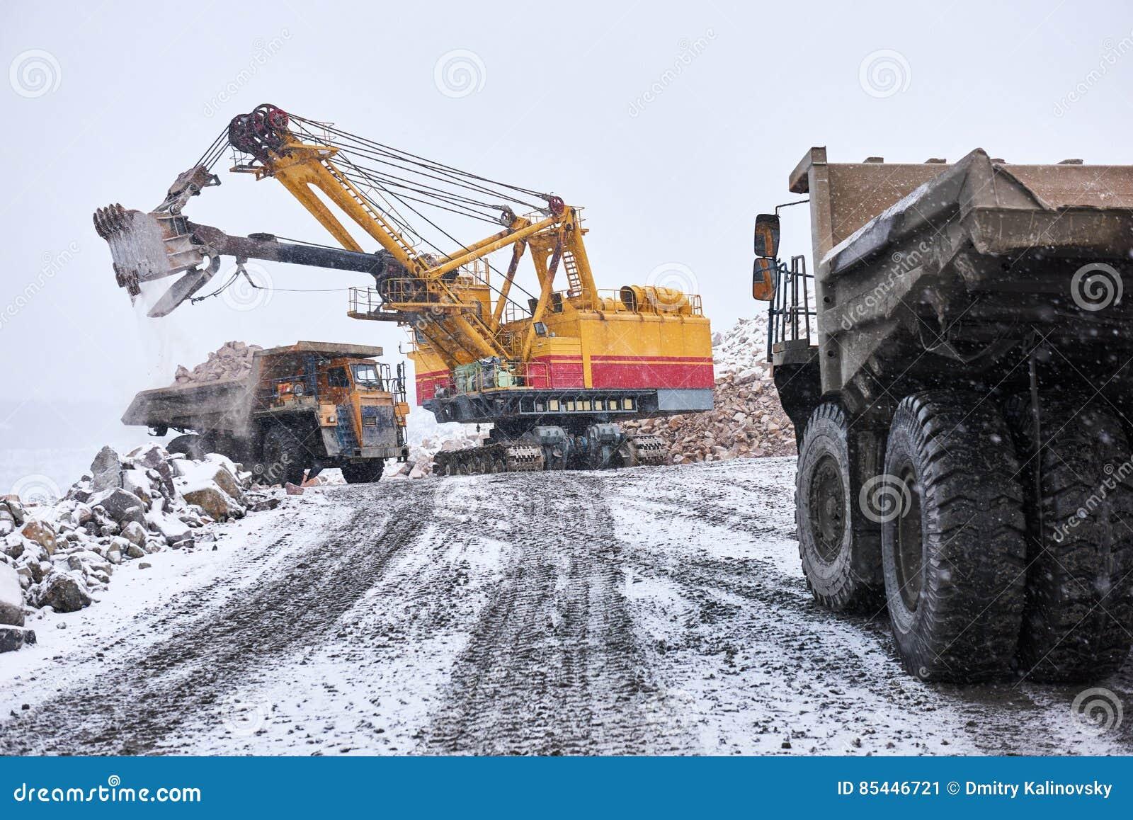 Excavator Loading Granite Or Ore Into Dump Truck At Opencast Stock Image Image Of Excavator Industrial 85446721