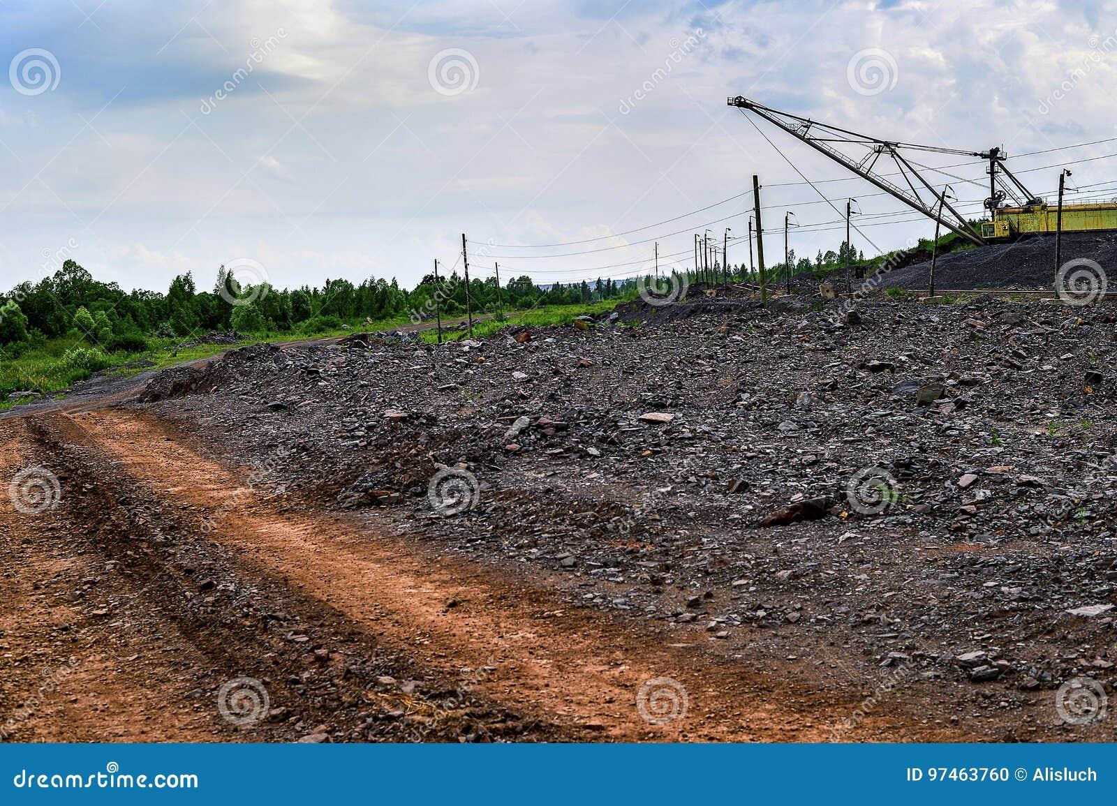 Excavator machine at excavation earthmoving work in quarry