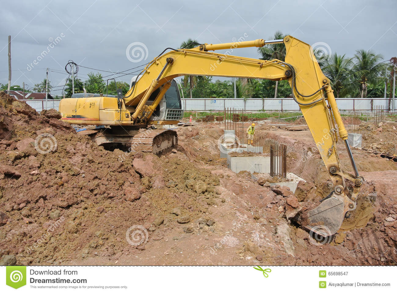 Excavator machine used to excavate soil at the for Three uses of soil