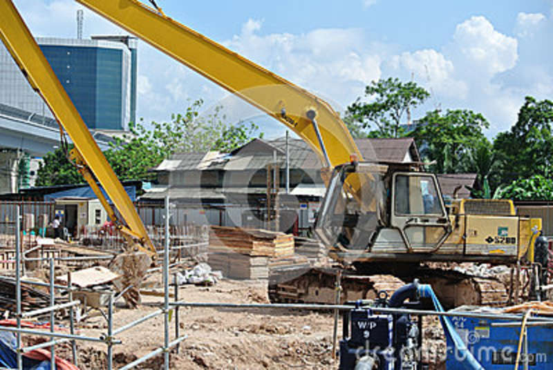 Construction Site Soil : Excavator machine used to excavate soil at the