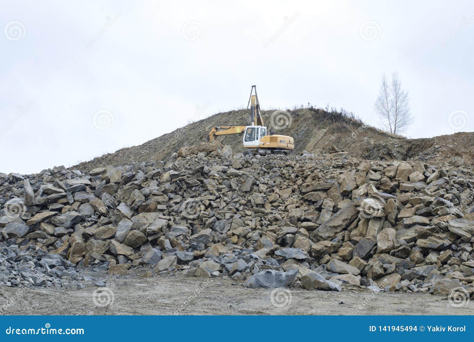 Excavator in an open pit mine