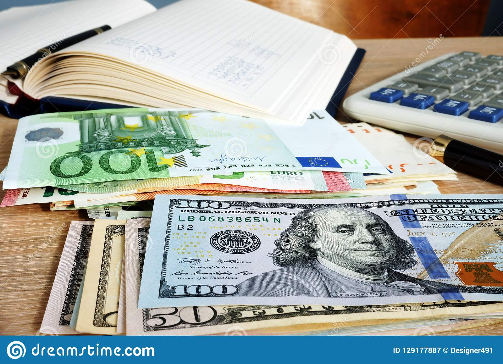 Stacks Of Euros And Dollars On Accountant Desk