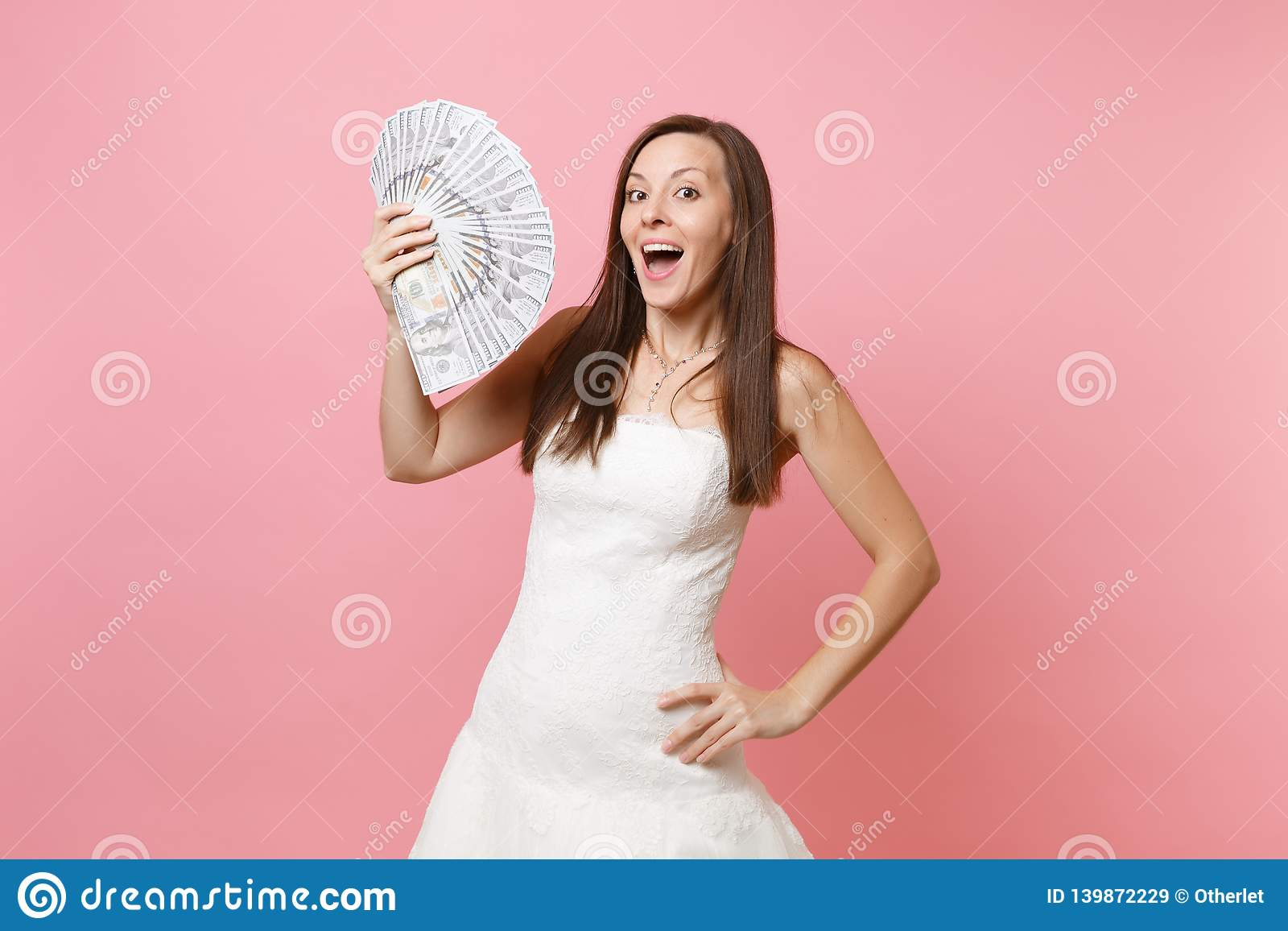 Excited Bride Woman In Lace White Wedding Dress Holding Bundle Lots