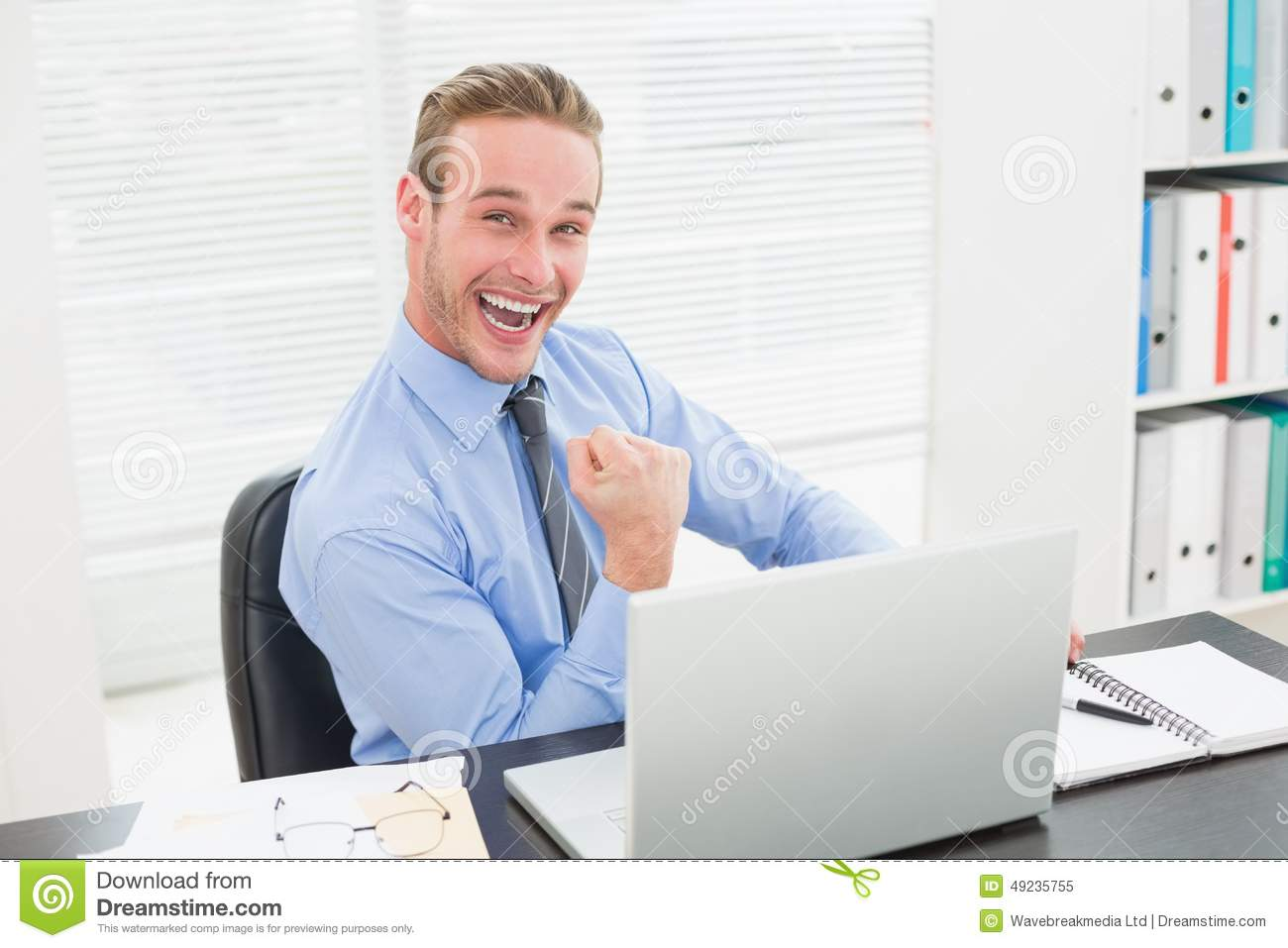 Excited Businessman Sitting At His Desk Cheering Stock ...