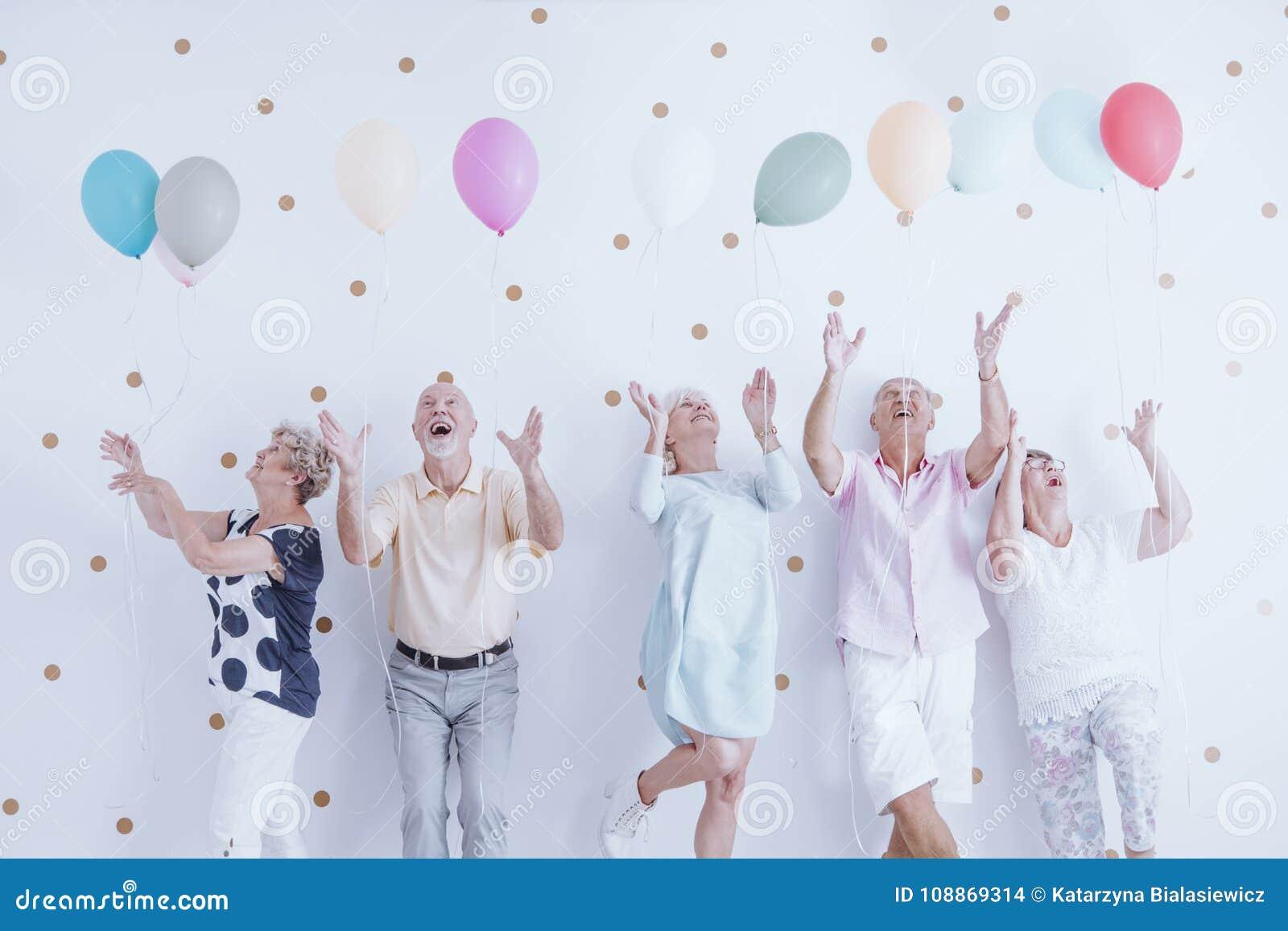 Excited elderly men and women