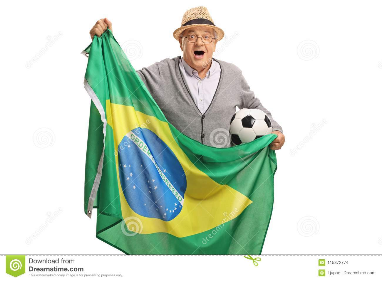 Excited elderly soccer fan holding a football and a Brazilian fl