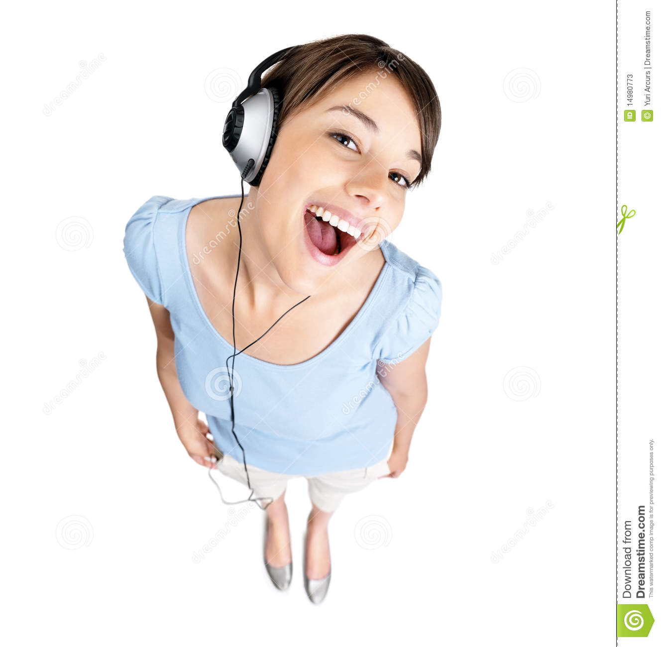 Stock Photos: Excited female listening to music on ...