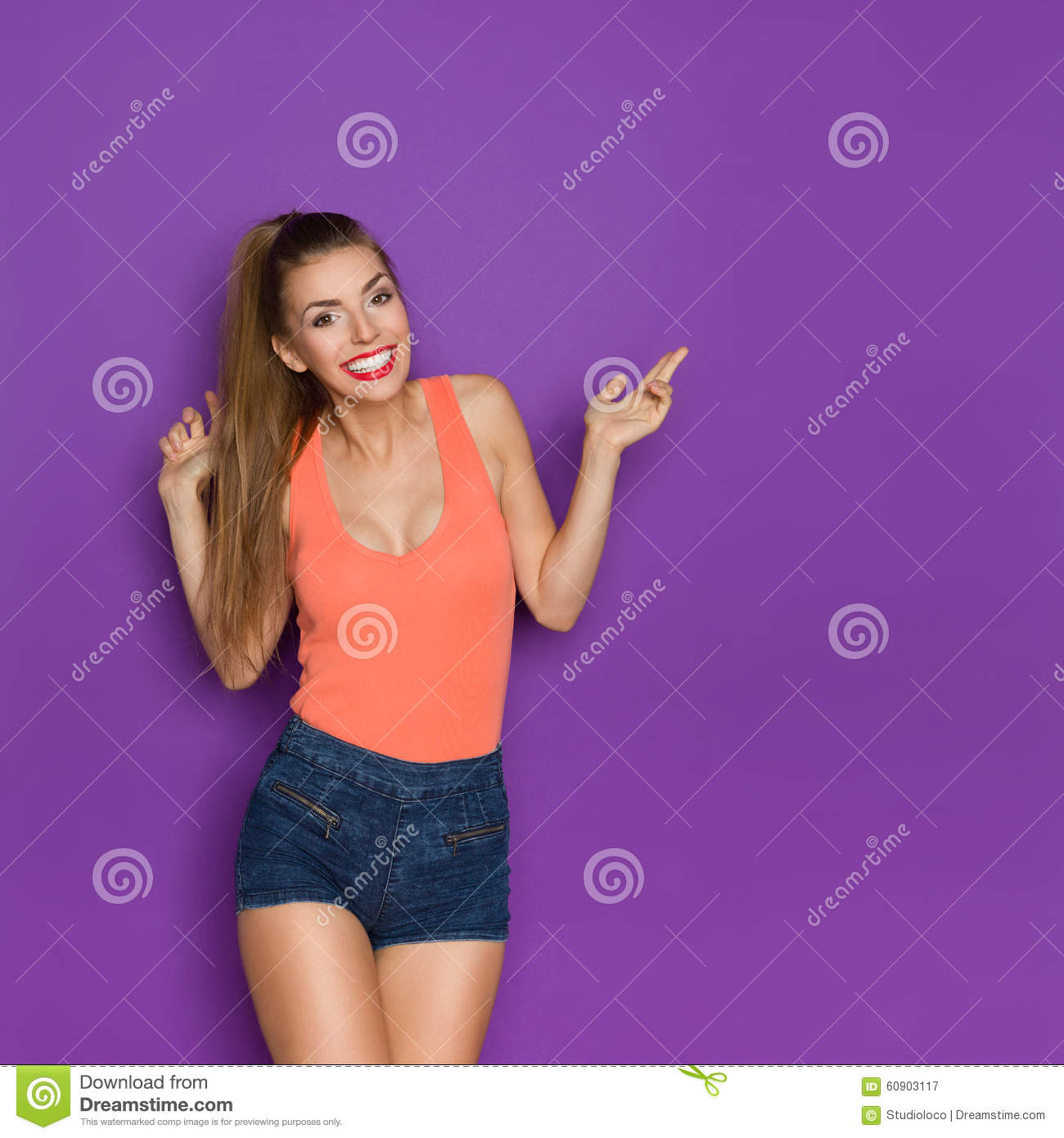 Excited Girl Pointing And Smiling Stock Image