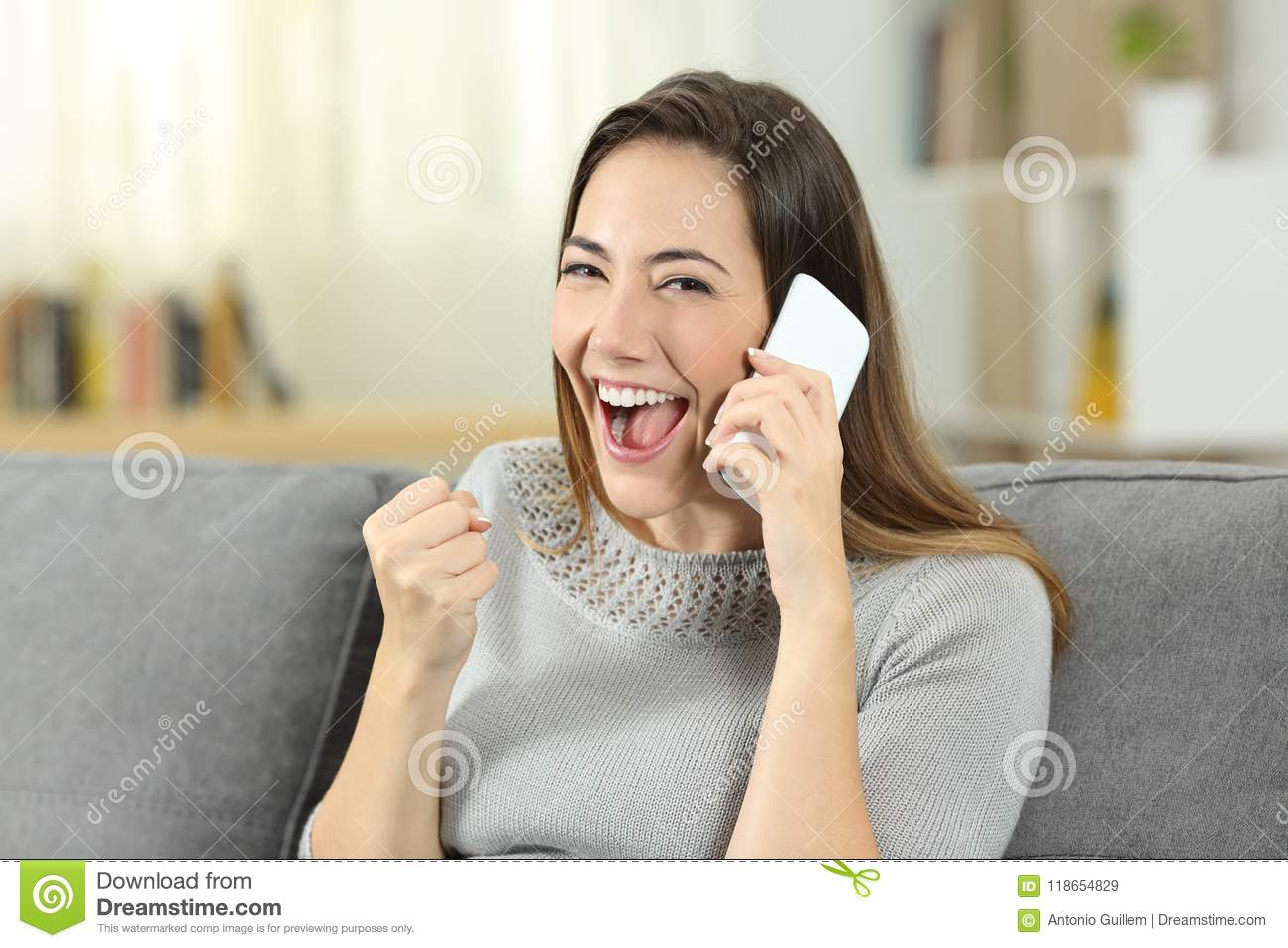 Excited Girl Receiving Good News During A Phone Call Stock