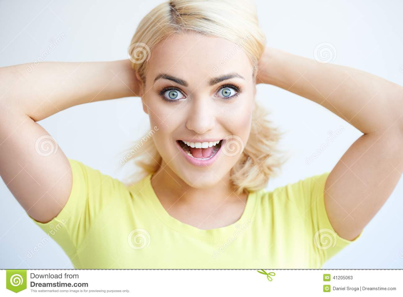 Excited happy attractive young woman
