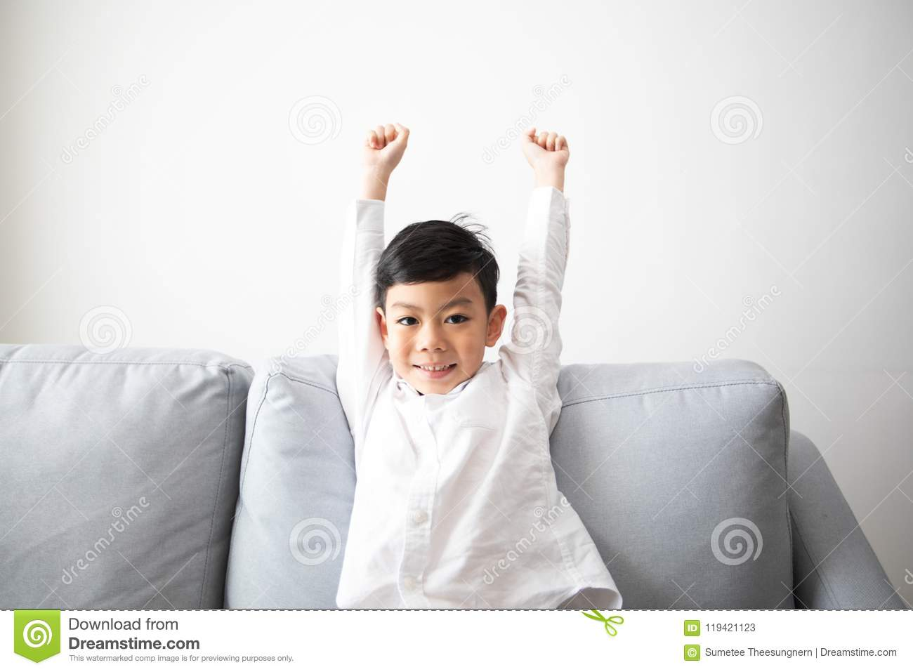 Excited and Happy family and son with arms raised while watching