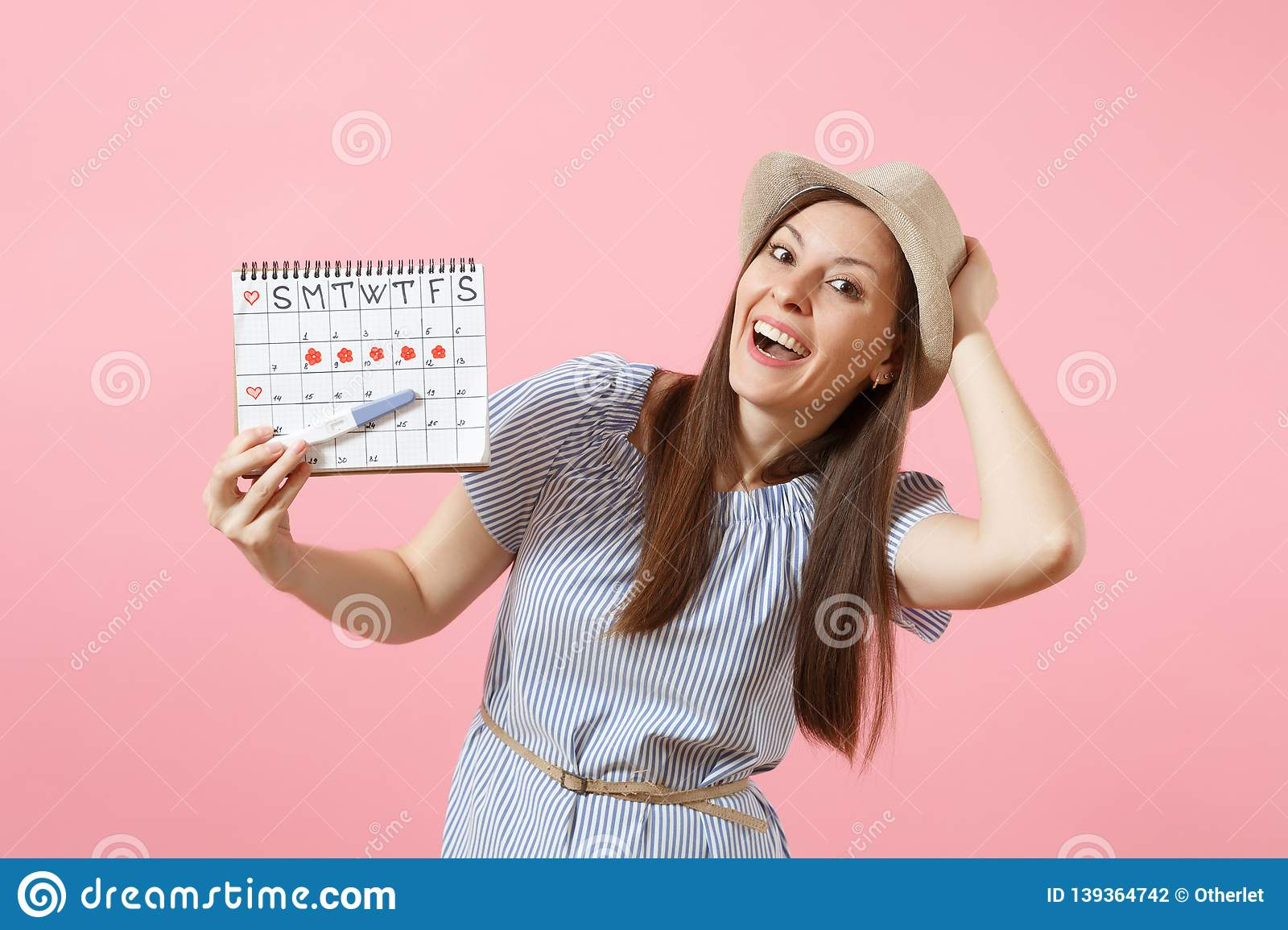 excited-happy-woman-blue-dress-hat-hold-