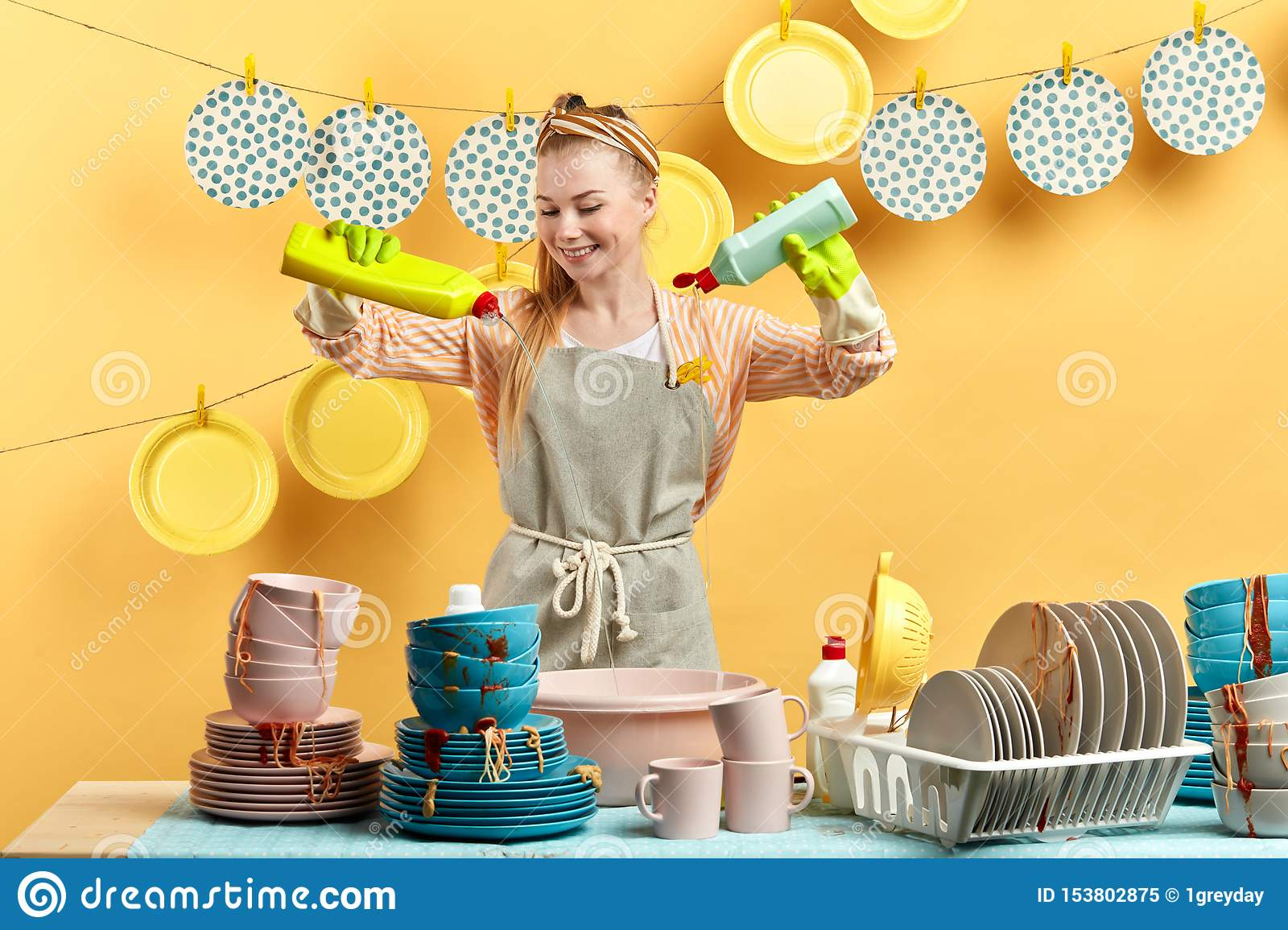 Excited happy young blonde woman doing housework