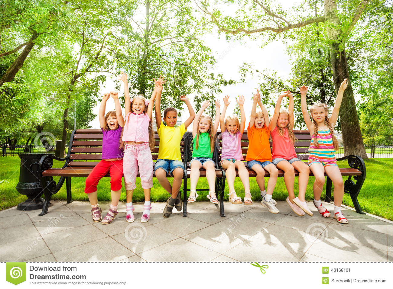 Excited Kids With Arms And Sit In Row On Bench Stock Photo ...