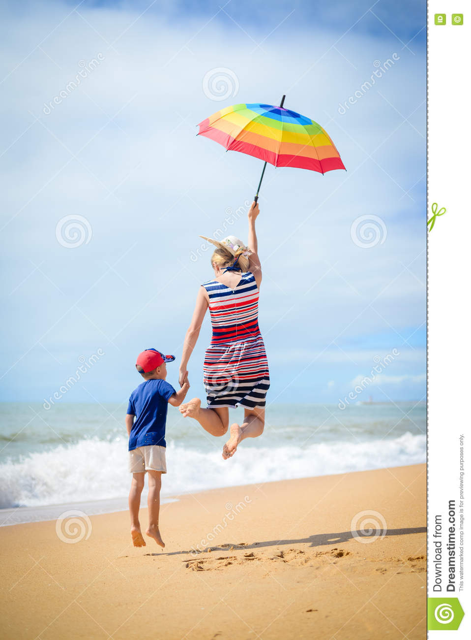 Excited happy mother and son have fun on beach run and jump on sunny  outdoors background 0ee46b4a9aa