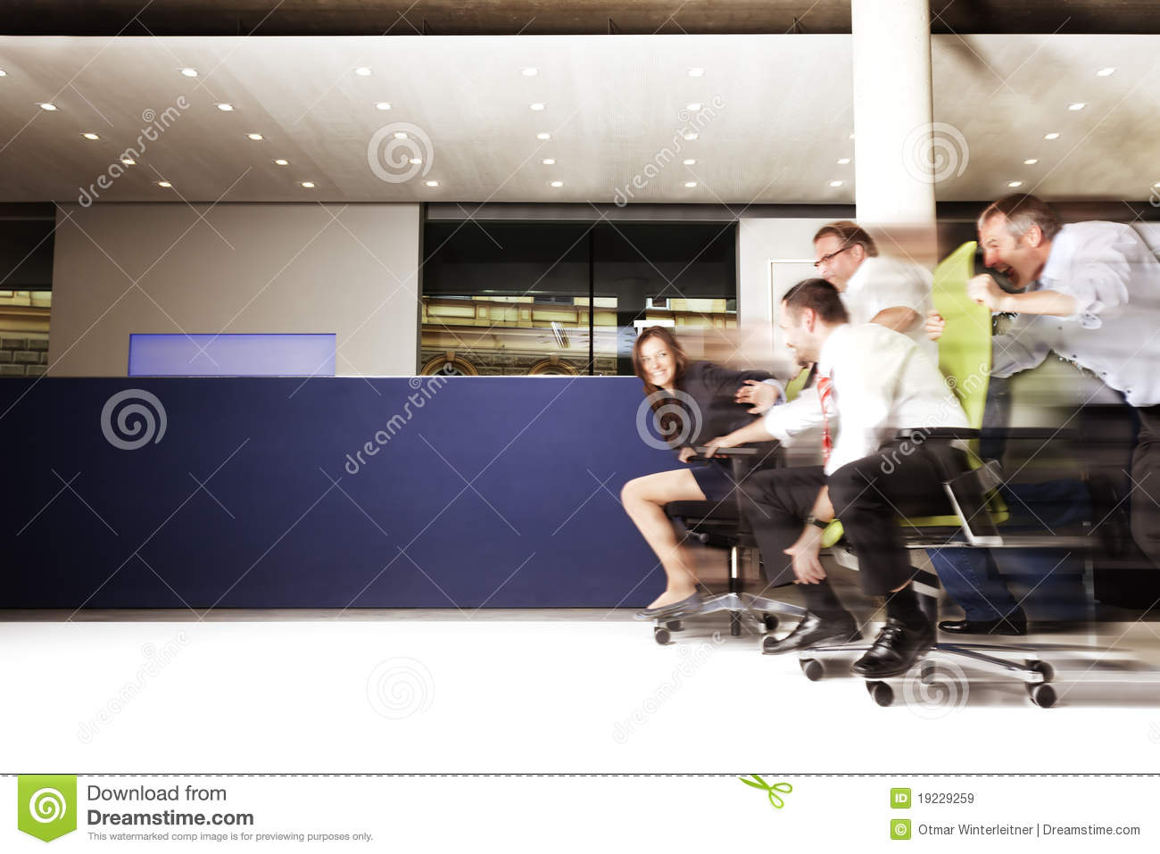 Excited Office Employees In A Chair Race. Royalty Free ...