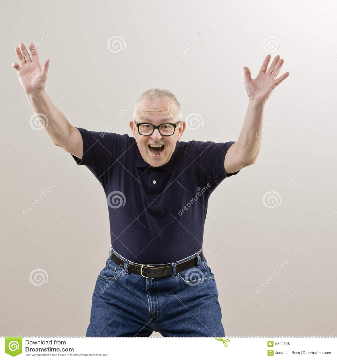Excited Senior Man With Arms Raised Royalty Free Stock