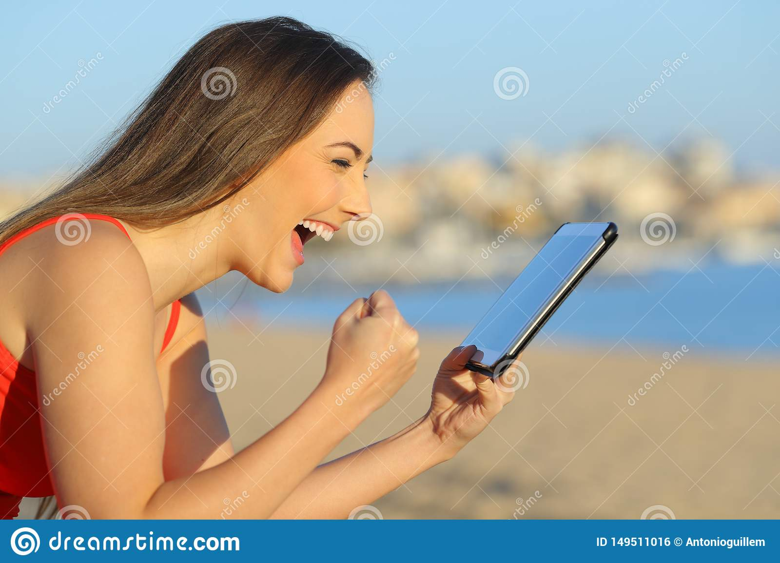 Excited teen finding wonderful content on tablet