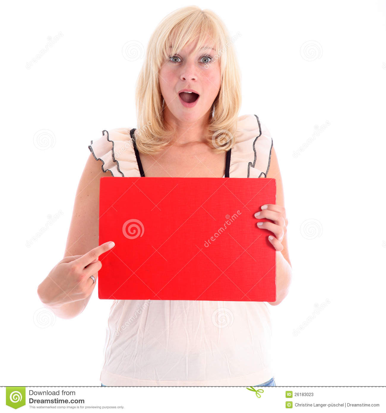 Excited attractive blonde woman with her mouth open in awe pointing to ...