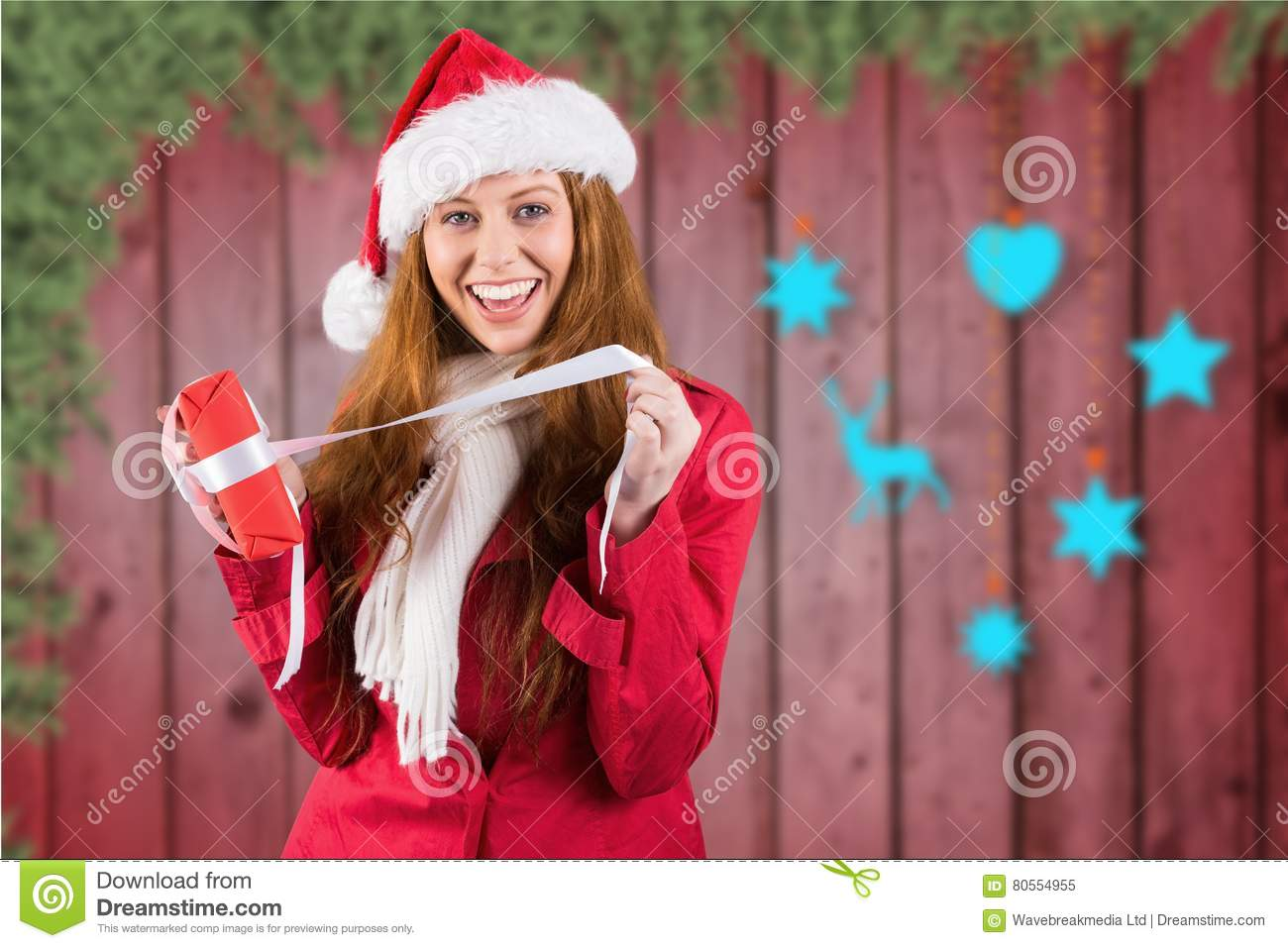 Excited Woman In Santa Costume Opening Christmas Gift Stock ...