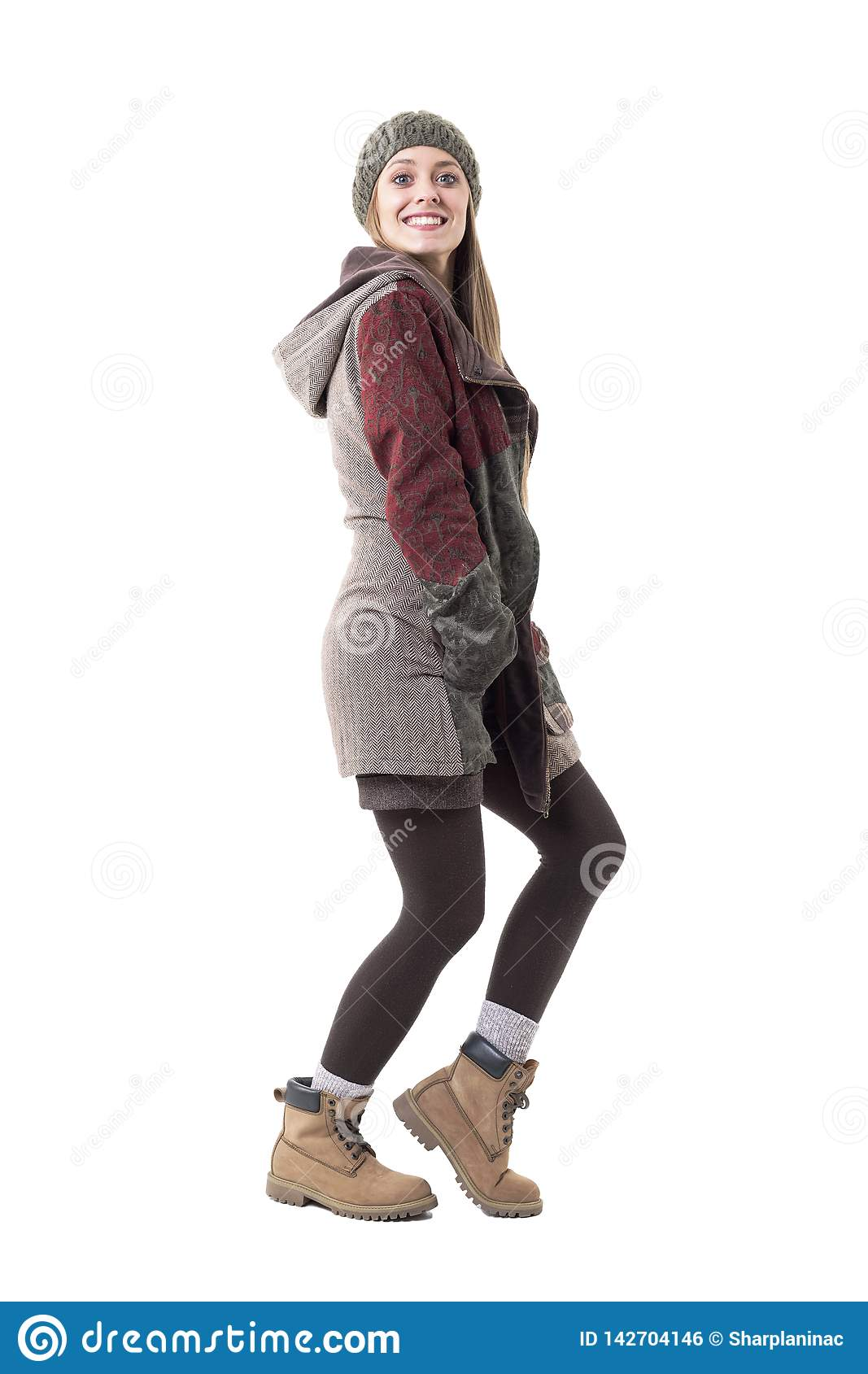 Excited young eager stylish woman anticipating good news smiling at camera