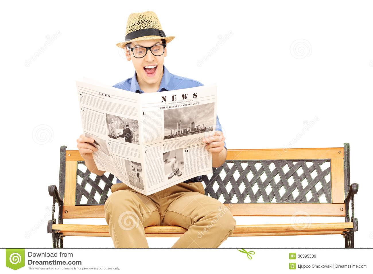 excited young man reading a newspaper seated on bench stock image