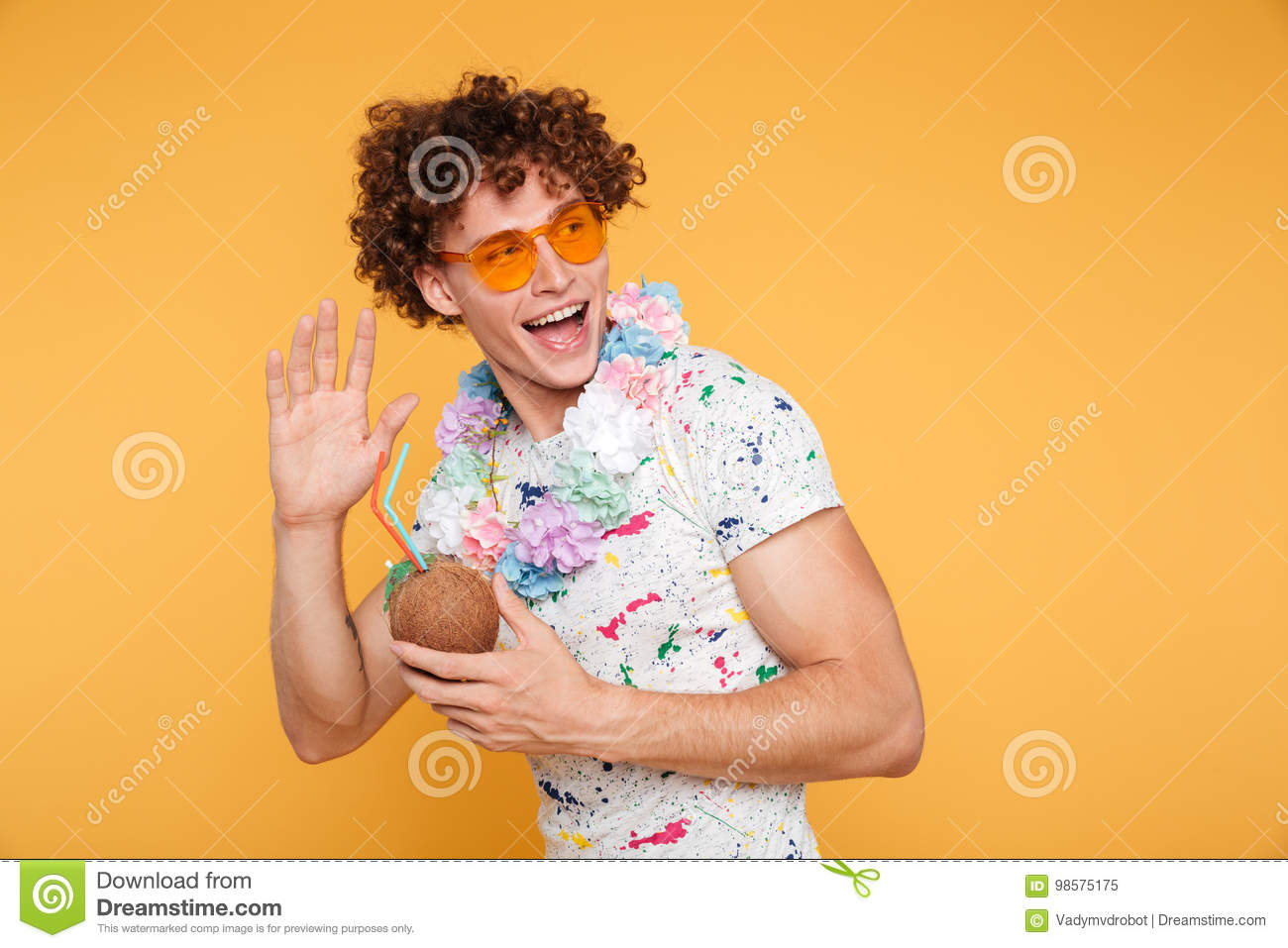 Excited Young Man In Sunglasses Holding Coconut Cocktail Stock Image