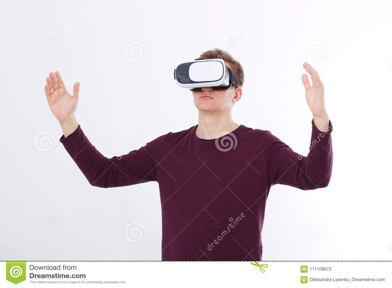 Excited young man in a VR headset, glasses . Virtual reality isolated on white background. Copy space and mock up