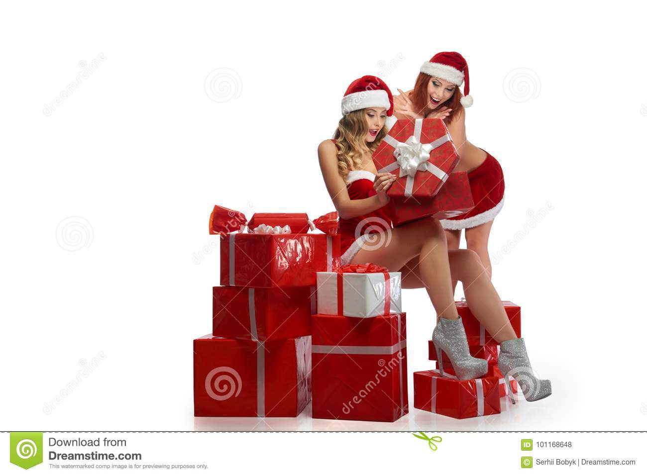 Two Christmas Girls Posing With A Pile Of Presents Stock Photo ...