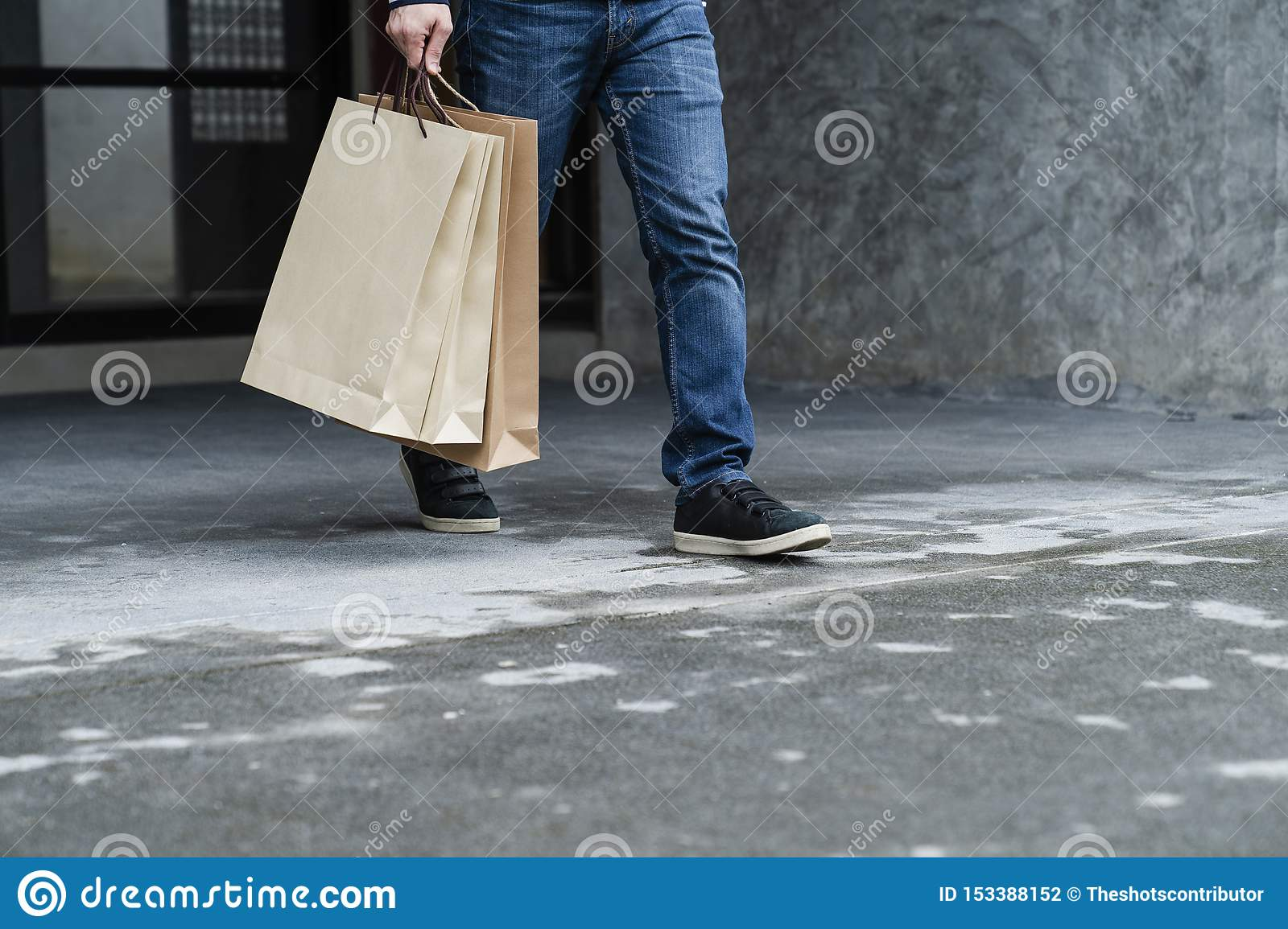 Exciting young shopping man hold bags